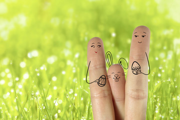 Conceptual easter finger art. Couple with bunny and painted eggs