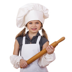 Сute little girl baking on kitchen and shows rolling-pin