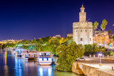 Seville, Spain at the Torre de Oro on the Guadalquivir River. - 80281841