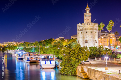 Leinwanddruck Bild Seville, Spain at the Torre de Oro on the Guadalquivir River.