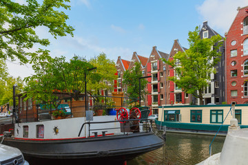 Amsterdam canal with picturesque houseboats, Holland