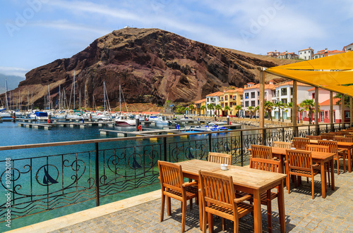 Reataurant tables in beutiful port, Madeira island, Portugal