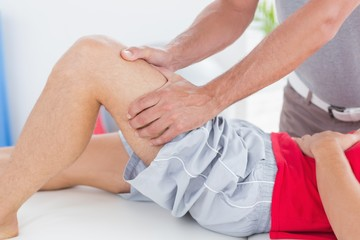 Man having thigh massage