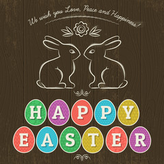 Card for  Easter day with  eleven colored eggs and rabbits