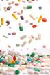 Leinwanddruck Bild - colorful medicine pills falling.