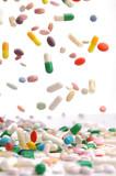 colorful medicine pills falling.