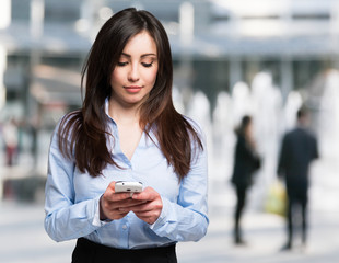 Woman using a mobile phone in a modern urban district