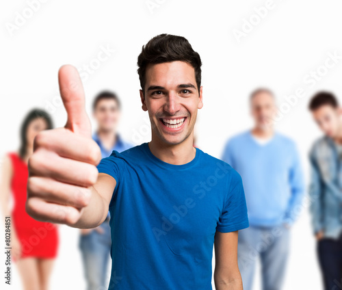 Smiling happy man in front of a group of people - 80284851