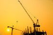 Construction site with cranes on silhouette background - 80285047