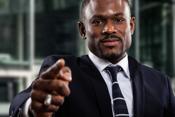 Businessman pointing his finger to you