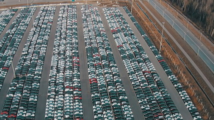 Flying Above Storage Parking Lot of New Unsold Cars
