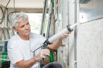 Caulking a window frame