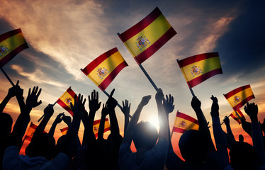 Silhouettes of People Holding Flag Spain Concept