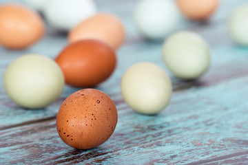 Assortment of different color fresh chicken eggs