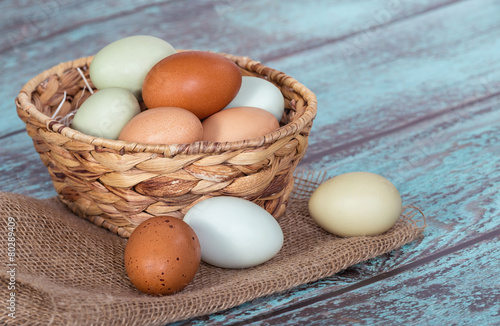 Fresh chicken eggs in a basket - 80289409