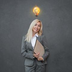 Business woman with idea light bulb above head