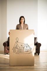 Cheerful woman holding a cardboard box