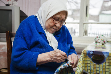 the grandmother knits a rug