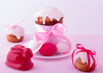 Decorated easter cakes and eggs  in pink pastel colours. Selecti