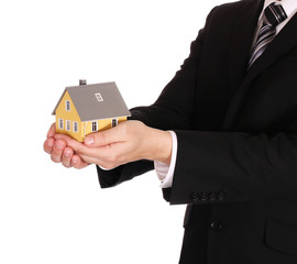 House model in businessman's hands isolated on white. Mortgage