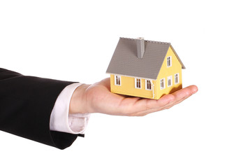 House model in businessman's hand isolated on white. Mortgage