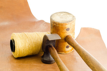 Leather hammer and hand tool for shoemaker in his workshop repai