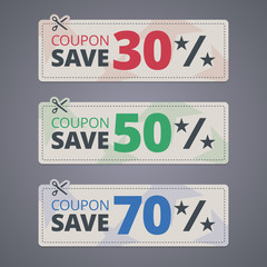 Scissors cutting coupons with discounts.