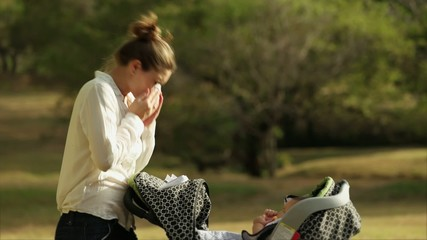 Woman Mother Little Baby Pushchair Sneezing For Allergy Park