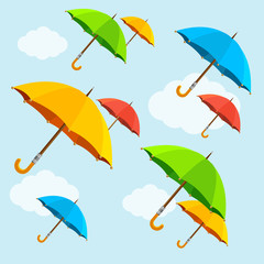 Vector colorful umbrellas fly with clouds. Flat Design