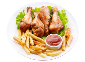 plate of grilled chicken leg with french fries