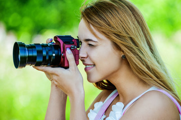 Beautiful girl with camera