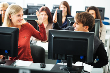 Students learning in computer lab