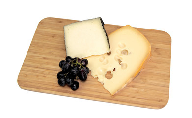 Cheese on kitchen board, isolated on white background