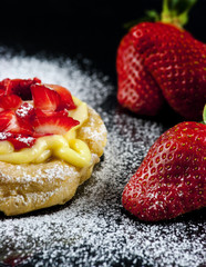 Zeppole with strawberry- tipical italian pastry