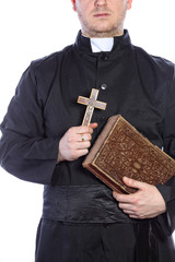 Priest holding a cross and bibles