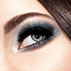 woman's eye with turquoise makeup. Long false eyelashes. macro s