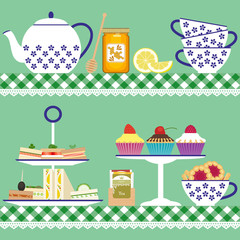 Tea set with sandwiches,  cupcakes and honey jar