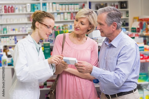 Pharmacist explaining the drug to costumers