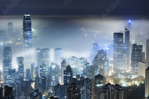 Foto op Canvas Hong-Kong Misty night view of Victoria harbor in Hong Kong city