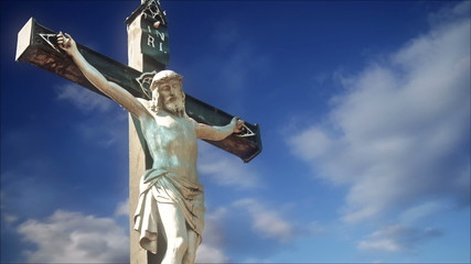 Crucifixion Statue with Time Lapse Clouds in background