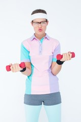 Geeky hipster girl lifting dumbbells