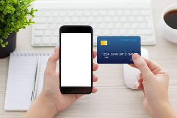 female hands holding phone with isolated screen and credit card