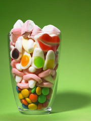 cup of all kind of junk food,gummy,chocolate and marshmallow