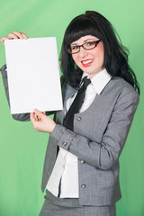 young woman in office dress with paper sheet on green background