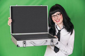 young woman in office dress with open case on green background