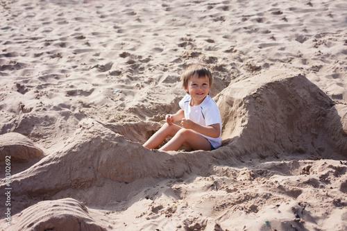 Plagát Adorable kid, playing on the beach