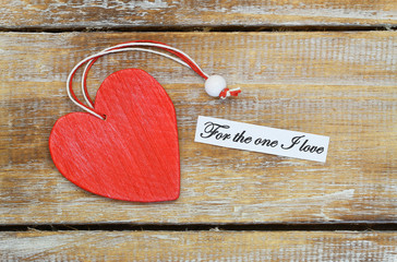 For the one I love card with red wooden heart on rustic wood