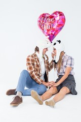 Geeky hipster in love couple looking at each other