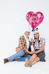 Geeky hipster in love couple looking at camera