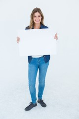 Woman holding poster